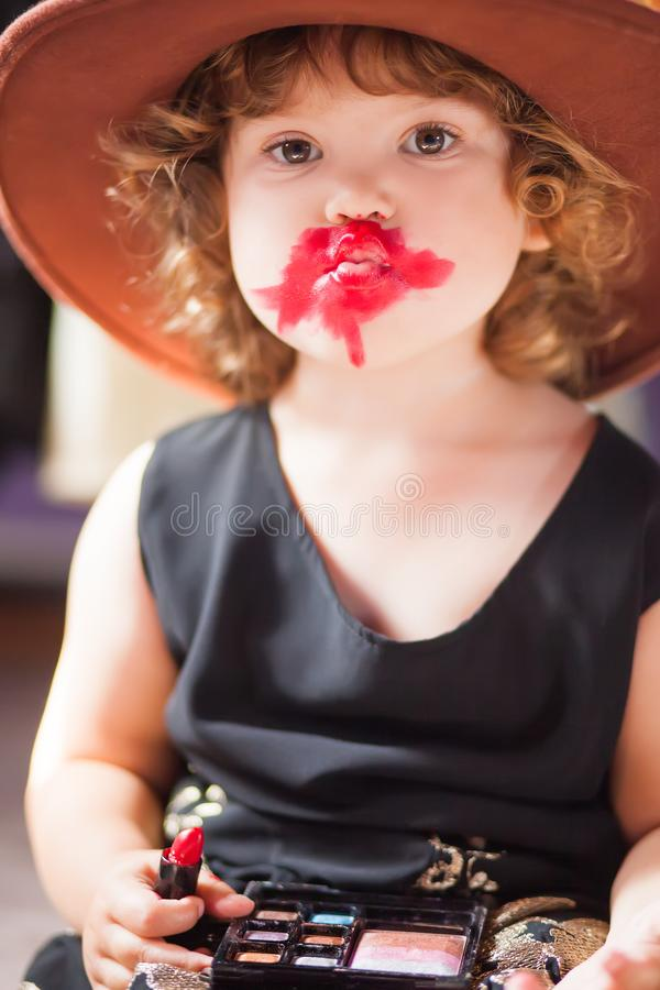 little-girl-trying-mothers-lipstick-growing-up-concept-wearing-clothing-evening-dress-felt-hat-making-make-mother-104592982